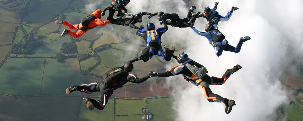 A team of skydivers in formation